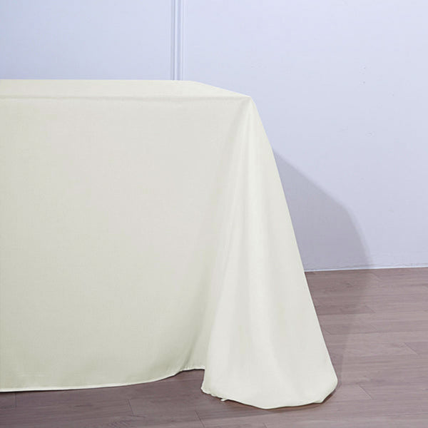"90""x156"" Ivory Polyester Rectangular Tablecloth"