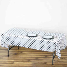 "54"" x 108"" 10 Mil Thick Perky Polka Dots Waterproof Tablecloth PVC Rectangle Disposable Tablecloth - White/Black"