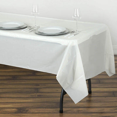 "54"" x 108"" Ivory 10mil Thick Disposable Plastic Vinyl Rectangular Tablecloth"