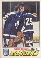 Wayne Thomas New York Rangers 1977 Opee Chee Autographed Card. This item comes with a certificate of authenticity from Autograph-Sports. PSM-Powers Sports Memorabilia