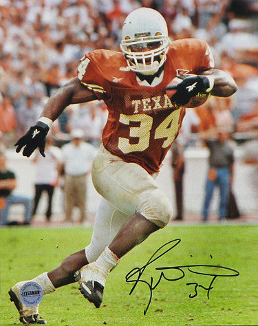 Ricky Williams signed Texas Longhorns 8X10 Photo #34 (orange jersey run-Heisman) PSM-Powers Sports Memorabilia