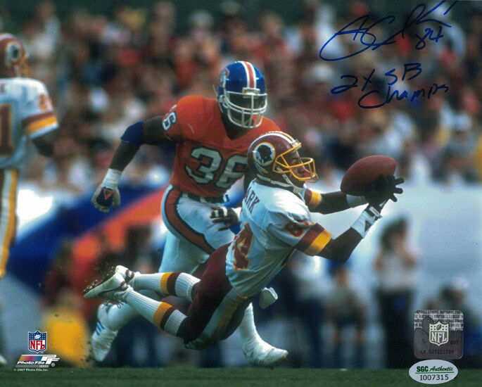Gary Clark Autographed Washington Redskins 8x10 Photo vs Broncos Blue SGC PSM-Powers Sports Memorabilia