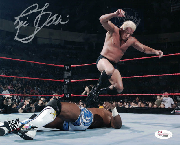Ric Flair Autographed WWE Wrestling 8x10 Photo (Stomping) JSA PSM-Powers Sports Memorabilia