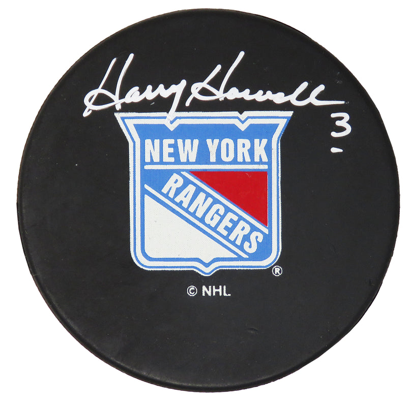 Harry Howell Signed New York Rangers Logo Hockey Puck PSM-Powers Sports Memorabilia