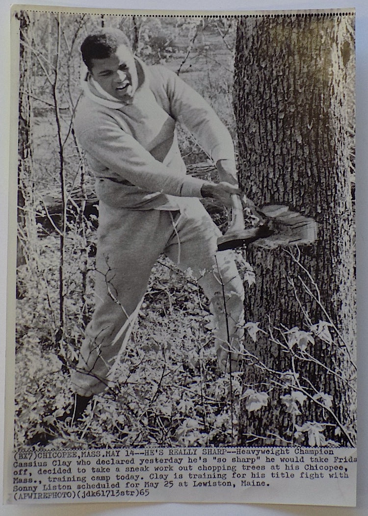 Muhammad Ali 1965 AP Wire Axe Swinging Photo PSM-Powers Sports Memorabilia