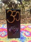 Tall Square Candle with an Om Symbol & inlaid Amethyst Crystal Cluster that illuminates when lit! - Hippie Dippies Crystal Candles