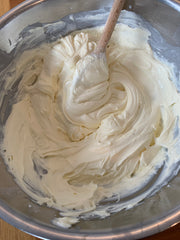 Mix the cream cheese, icing sugar, vanilla extract and double cream