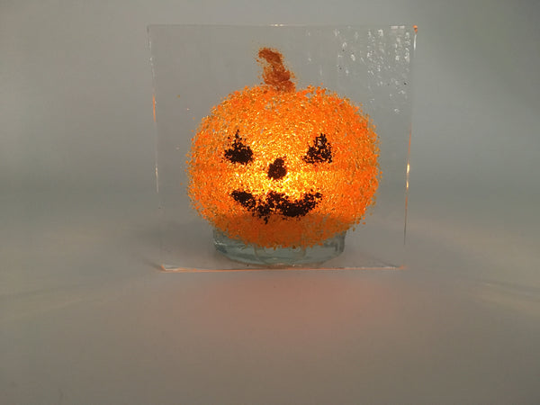 Jack o'lantern tea light candle holder