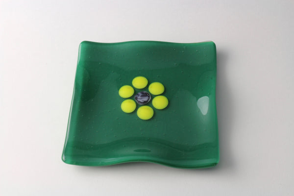"Green 5.5"" square fused glass dish with yellow flower"