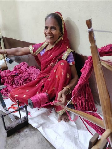 woman collecting recycled sari yarn
