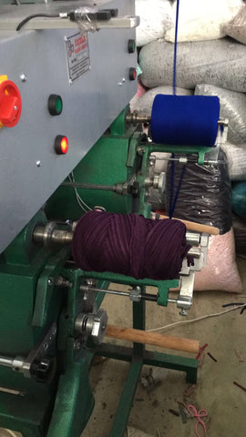 The yarn rolling machine in action