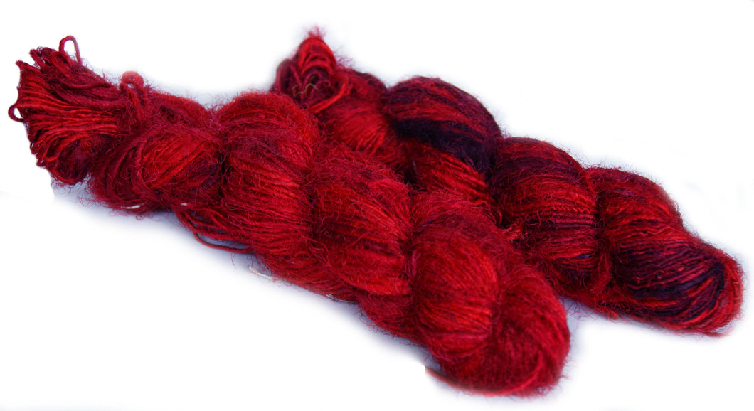 Red recycled spun sari silk yarn