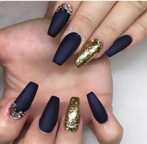 Gold glitter navy blue nail design