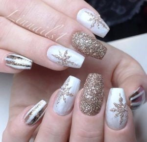 Golden snowflake patch nail design