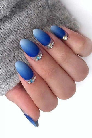 Bright blue ombre nail design