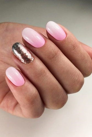 Pink and gold glitter ombre nail design