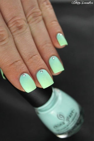 Turquoise rhinestone ombre nail design