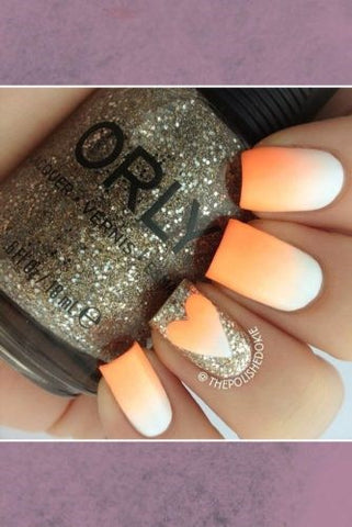 Heart shaped orange ombre nail design