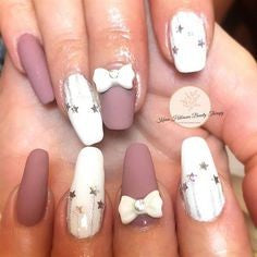 Bow and Star Nail Design