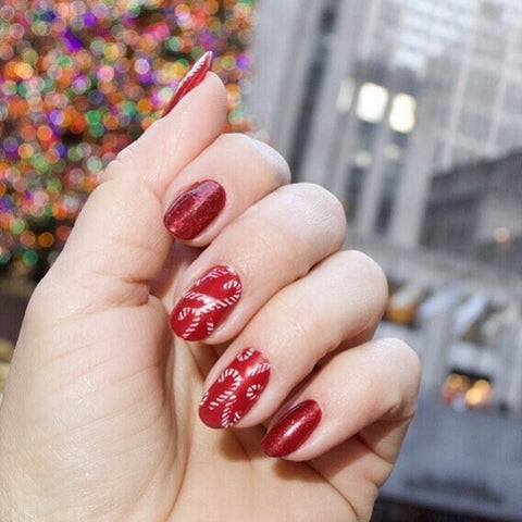 This Red Candy Cane Christmas Nail Design