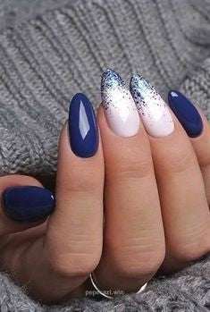 Snow and Blue Winter Nail Designs