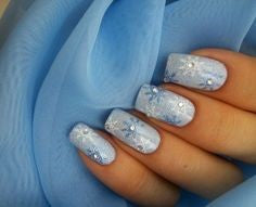 Rhinestone and snowflake Winter Nail Designs