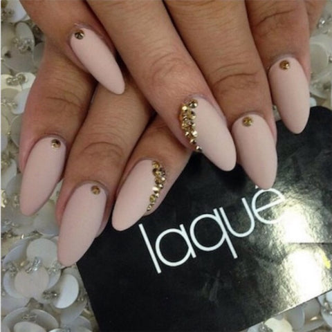 These pretty nude nails have the perfect amount of glam for everyday