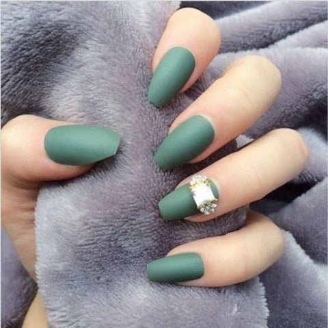 A diamond accent nail adds some extra glam to a matte manicure