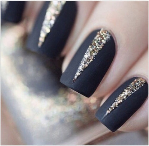 Sliver of glitter peeking out from these matte black nails.
