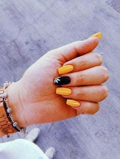 White Flower and Orange Nail Idea