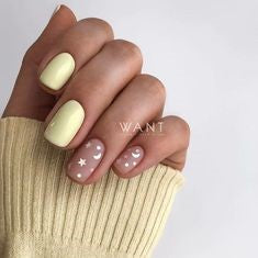 Yellow pastel nail design