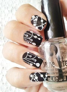 Jewelry style black and white nail design