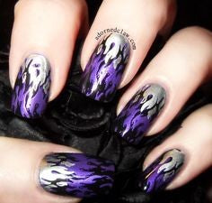 Purple and silver flame nail design