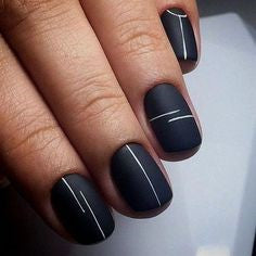 White line nail design on black background