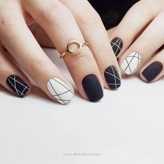 Black and white staggered nail design