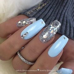 Light blue glitter crystal nail design