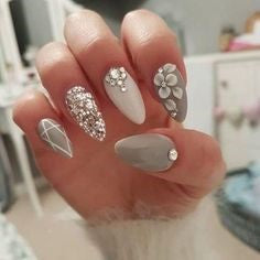 Matte black and white crystal nail design