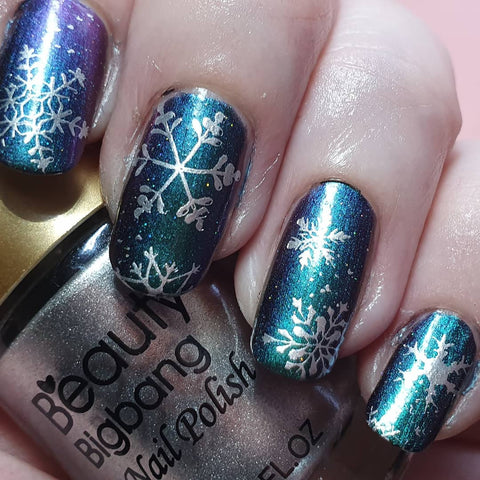 Glitte blue Christmas snowflake nail stamping design