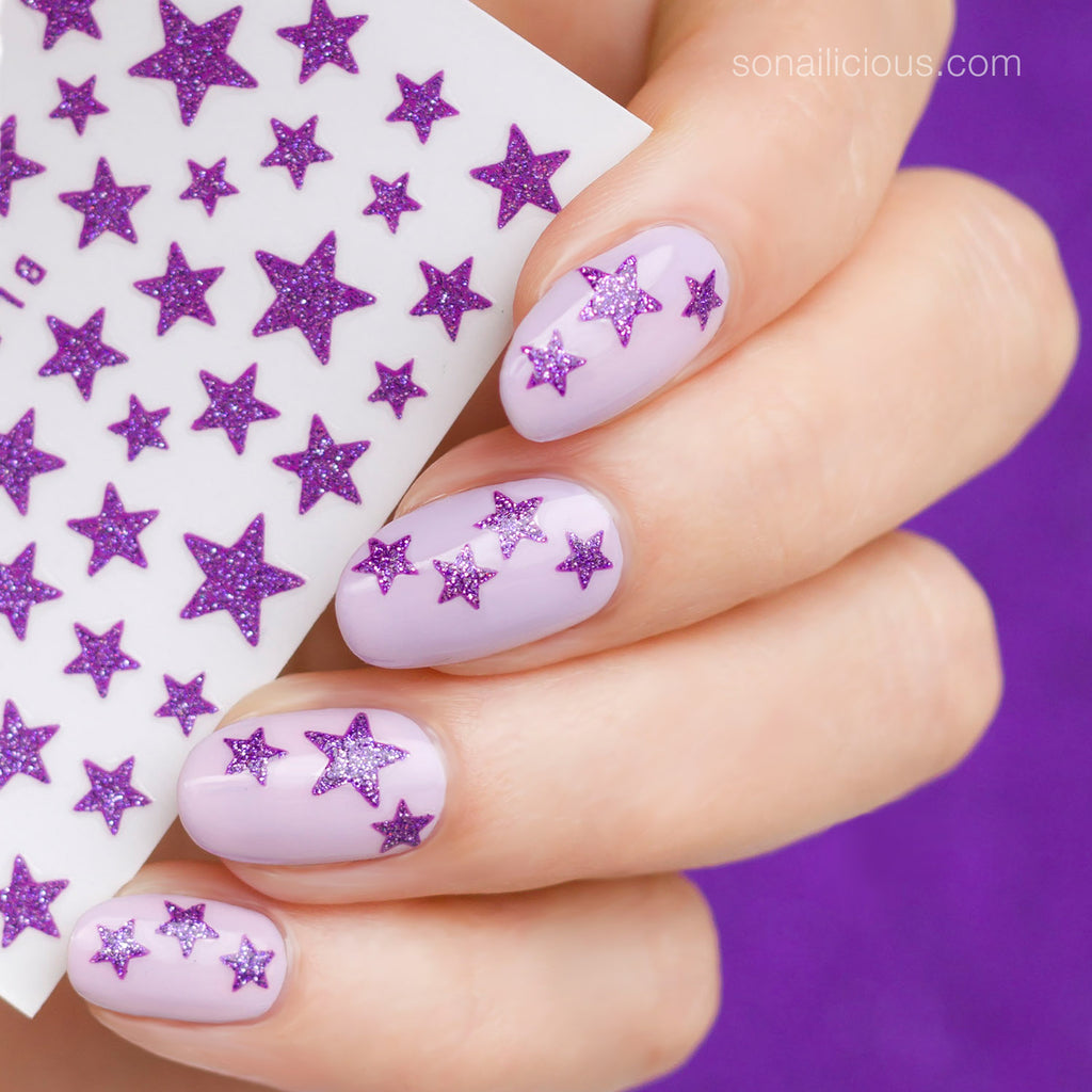 purple nails with glitter star stickers