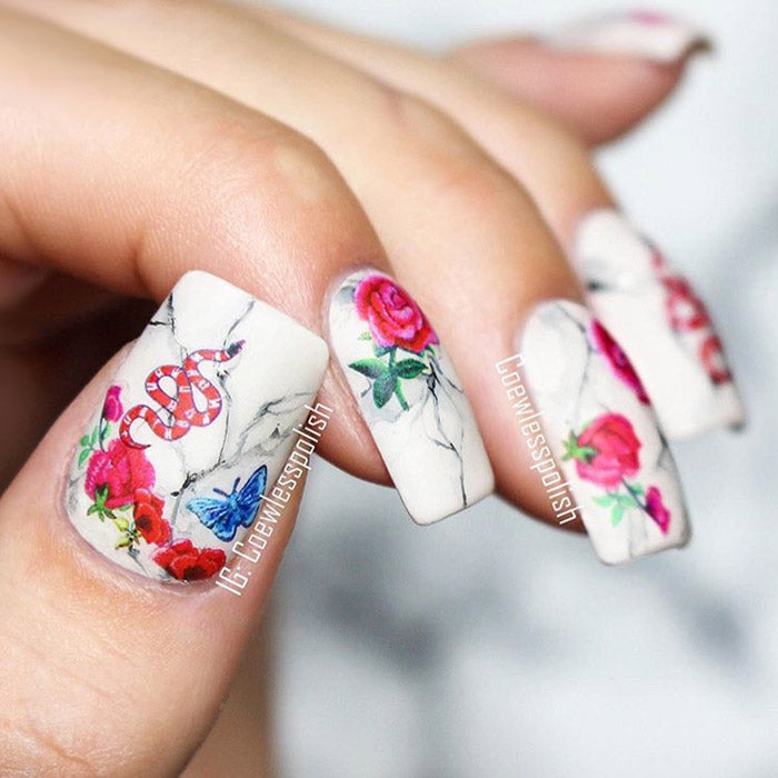 marble snake nails with SoNailicious stickers