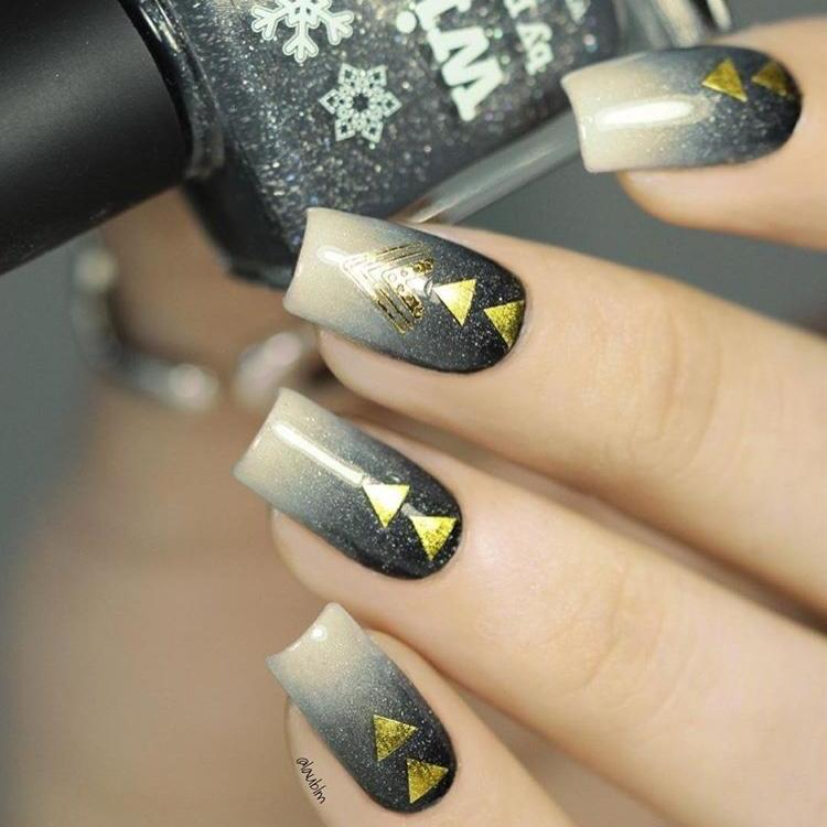 Festival nail art with gold stickers