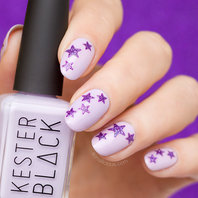Purple nail art with star stickers