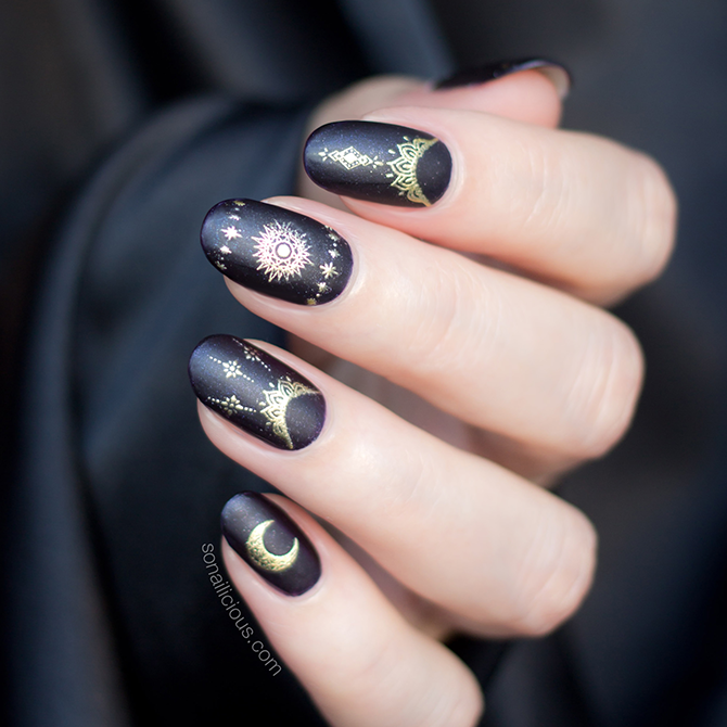 Black and gold nails with nail stickers