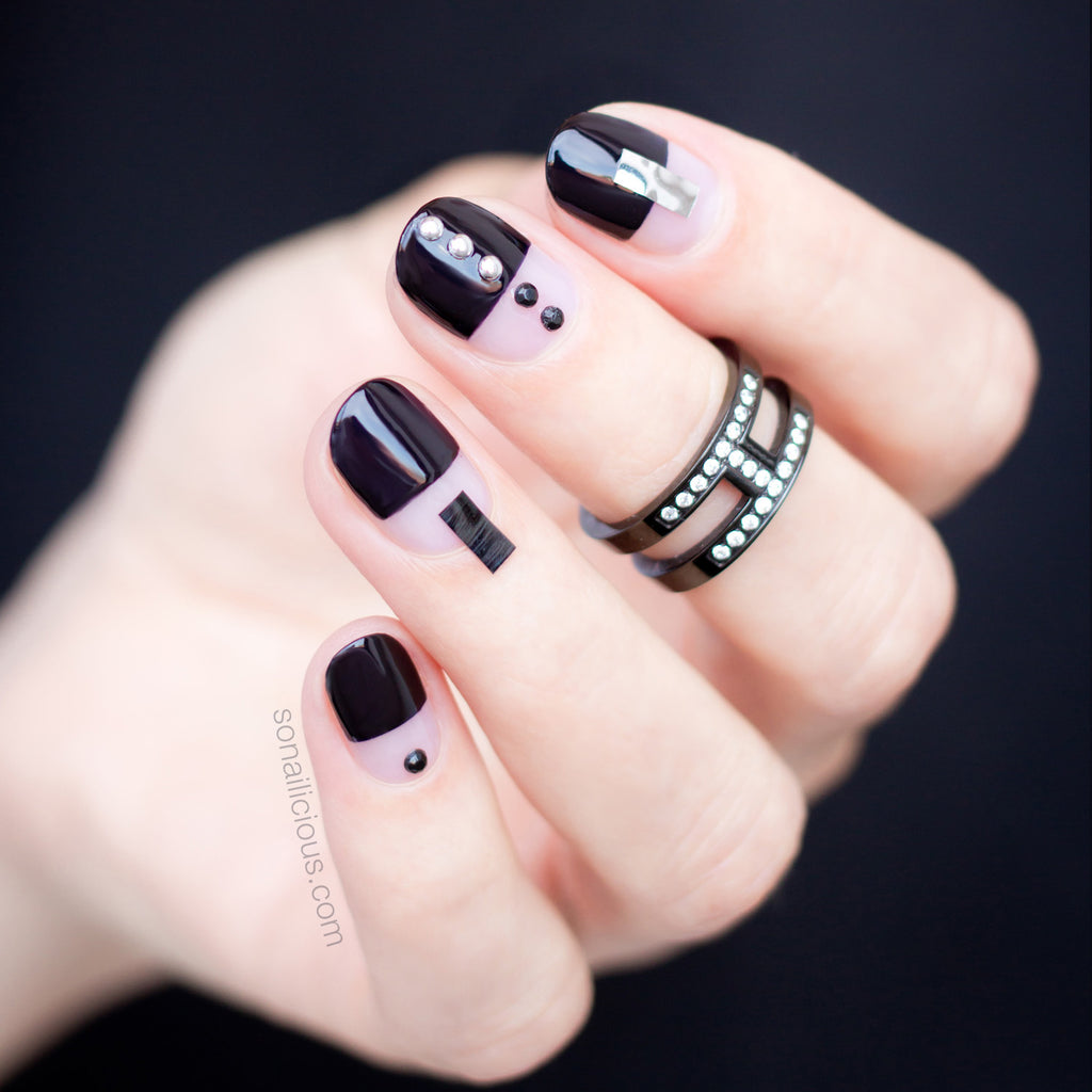 black nail design with silver studs