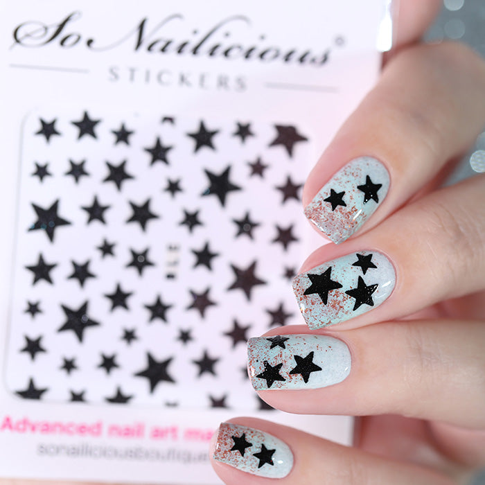 Star nails with black glitter star stickers
