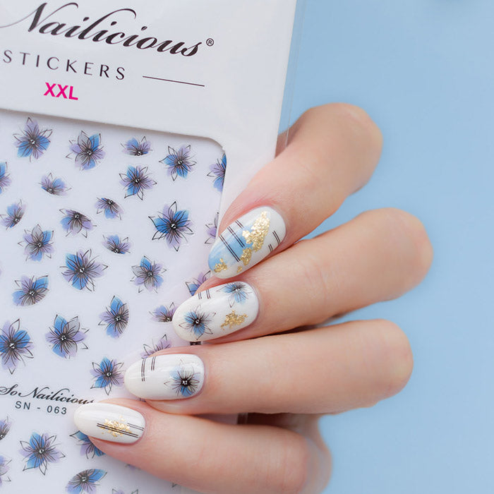blue and white nails with sonailicious stickers