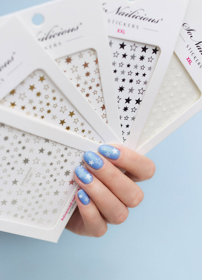 white and blue star nails