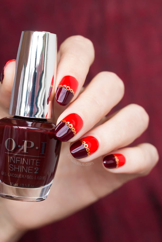 Red nails with gold nail stickers
