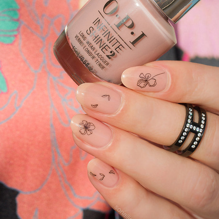 Nude and black nails with Ink Flower stickers