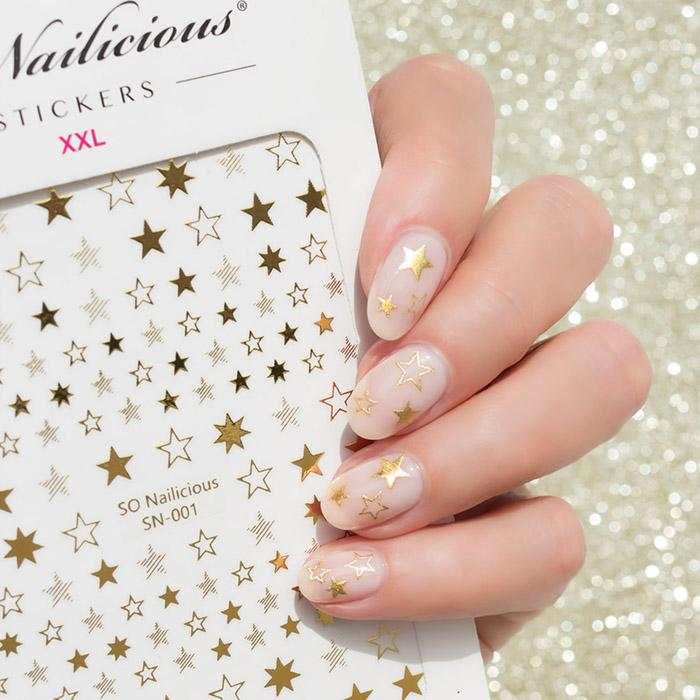 gold and nude nails with star stickers